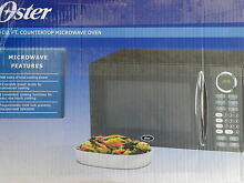 Oster OGB8902 Microwave 0 9 cu  ft  900 Watts Countertop Microwave Oven OGB8902