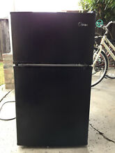 Mini fridge  lightly used  black  fridge and freezer