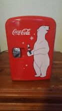Coca Cola mini fridge 12 inches tall 7 inches wide  Heat and cooling features