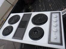 Whrirlpool 36 in downdraft cooktop very nice low use