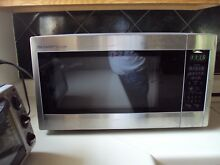 SHARP  brand 1 8 Cu  Ft  COUNTER TOP MICROWAVE  STAINLESS STEEL R  551ZS