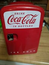 Coca Cola mini personal refrigerator holds up to 6 cans