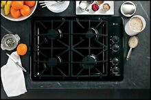 GE Profile PGP943DETBB 30 Inch Gas Cooktop with 4 Sealed Burners  Black