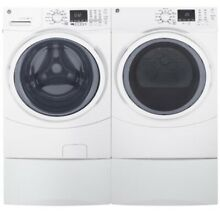 NIB GE 4 5 cu ft Electric Front Load Washer   Dryer Set Pedestals Included