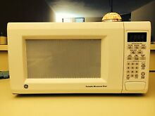 GE Microwave Oven 1000 watts   Model JES1142WD04