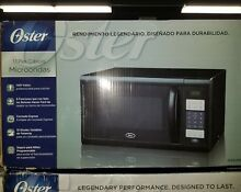 Oster OGZB1101 Countertop Microwave Oven   1000 Watts   1 1 cu ft