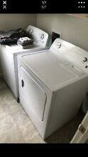 White Kenmore series 100 washer dryer set electric