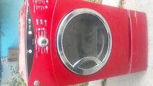 GE RED ELECTRIC DRYER HAS A DRAWER STORAGE AT THE FRONT BOTTOM