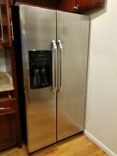 Frigidaire Side by Side Refrigerator   Silver  water and ice maker