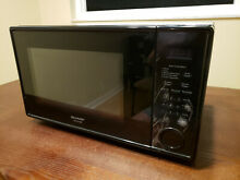 Sharp R309YK    1 1 Cu  Ft  Mid Size 1000 Watts Black Microwave