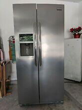 Side by side refrigerator freezer  Stainless Steel  Excellent Condition  H   70