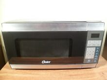 Oster  7 Cubic Foot Countertop Microwave Model OGT6701