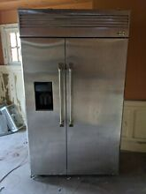 48  GE Monogram refrigerator   stainless steel   good condition