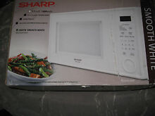 Sharp Microwave Oven 1 1 cu ft White 1000 Watts R 309YW Reheat Defrost NEW