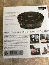 New in box  precision induction cooktop by hearthware