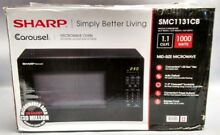 Sharp Carousel 1 1 Cu  Ft  Countertop Microwave black
