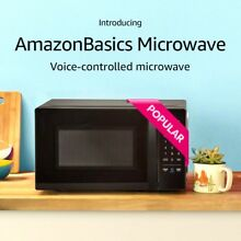 Amazon Basics Microwave  Compact  0 7 Cu  Ft  700W  Works with Alexa