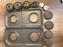 Used Parts for GE JGBP85CEH3CC  Drip Pans WB34K10019 X 2  Burners X 4  Knobs X 2