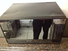 Samsung MG14H3020CM   1 4 CF  950W Stainless Mirror Finish  Microwave   Dents