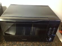 Samsung MC11K7035CG 1 1 cu  ft    Convection Microwave Oven   Black   Used