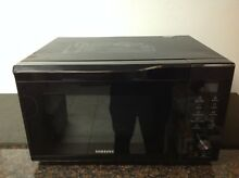 Samsung MC11K7035CG 1 1 cu  ft  Convection Microwave Oven  Black Stainless  Used