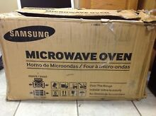 Samsung ME21F606MJT 2 1 cu  ft  Over the Range Microwave Oven   Stainless Steel