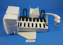 WR30X10093  GE Refrigerator Ice Maker w Side Fill Cup   C1 4
