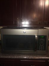GE Series 1 7cu  ft  Over the Range Sensor Microwave Oven