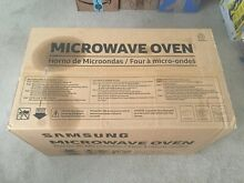 Samsung 1 6 cu  ft  1000 Watts Over The Range Microwave Oven in Black   NEW