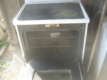 GE electric range   black   white with glass top  need parts for repair