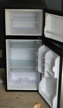 Appliances 4 3cf Magic Chef refrigerator freezer  approximately one year old