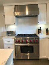 36  Wolf range and oven with matching Imperial wall hood  Impeccable condition