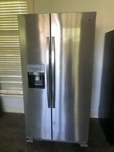 New kenmore side by side stainless steel refrigerator  Valued at  1200