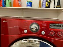 LG front load washer and dryer set with pedestals wild cherry red