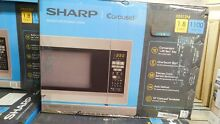 Sharp   1 8 Cu  Ft  Full Size Microwave   Stainless steel Model  R 551ZM