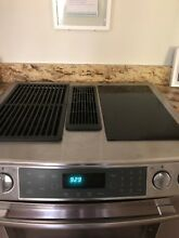 Jenn Air downdraft oven with glass cooktop and grill feature  slightly used