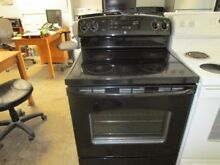 Used 30  wide GE black smooth top range good working condition very clean