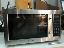 Magic Chef MCPMCD1310ST MCD1310ST 1 3 cu ft  Microwave Stainless Steel  DENTS