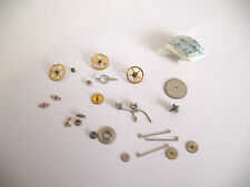 IWC,INTERNATIONAL 83  ASSORTED NEW OLD STOCK MOVEMENT PARTS