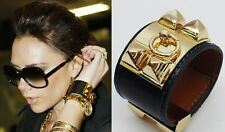FAUX LEATHER CUFF BRACELET WITH PYRAMID STUDS CELEBRITY STYLE