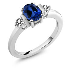 1.10 Ct Oval Blue Simulated Sapphire White Diamond 18K White Gold Ring