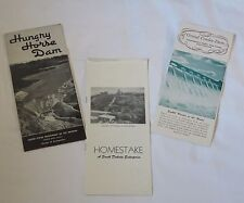 Old brochures Hungry Horse Dam, Grand Coulee Dam, Homestake mine