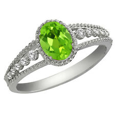 0.96 Ct Oval Green Peridot and White Topaz Sterling Silver Ring