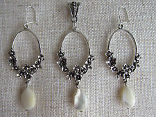 Long Drop Earrings on Sterling Silver Safety Wires with Mother of Pearl.