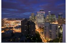 Poster Print Wall Art entitled High angle view of buildings lit up at night,