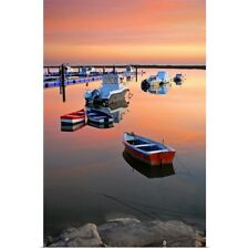 Poster Print Wall Art entitled Moored boats on sea at sunset.