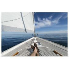Poster Print Wall Art entitled Man's feet crossed on sailboat