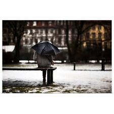 Poster Print Wall Art entitled Back of woman with umbrella sitting in the rain