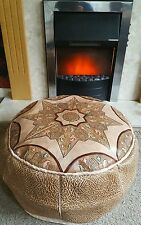 Moroccan leather pouffe with star design, neutral tones, with green/red accents