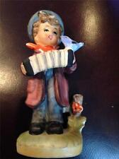 Boy Playing Accordian to a Blue Bird Figurine Pre-Owned